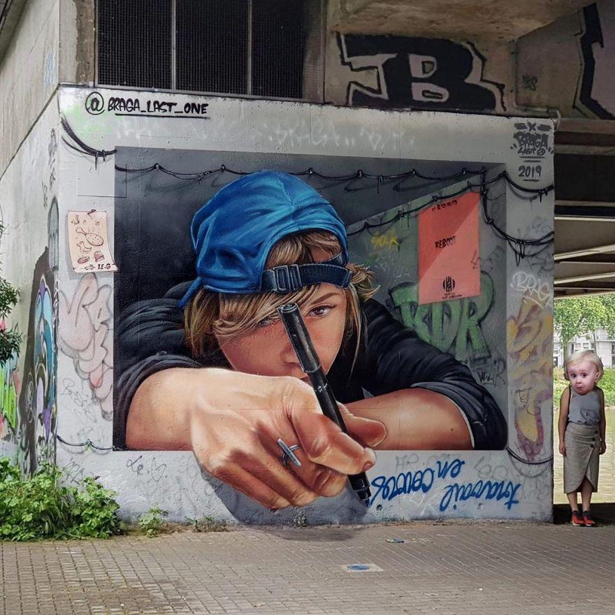 French artist turns an abandoned natural gas tank into a giant cat 5e9e99d451f0c 880 - Esse artista de rua é capaz de confundir a mente de qualquer um com suas belas artes ilusionistas