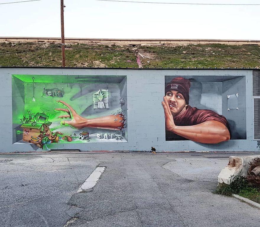 French artist turns an abandoned natural gas tank into a giant cat 5e9ed558e966a 880 - Esse artista de rua é capaz de confundir a mente de qualquer um com suas belas artes ilusionistas