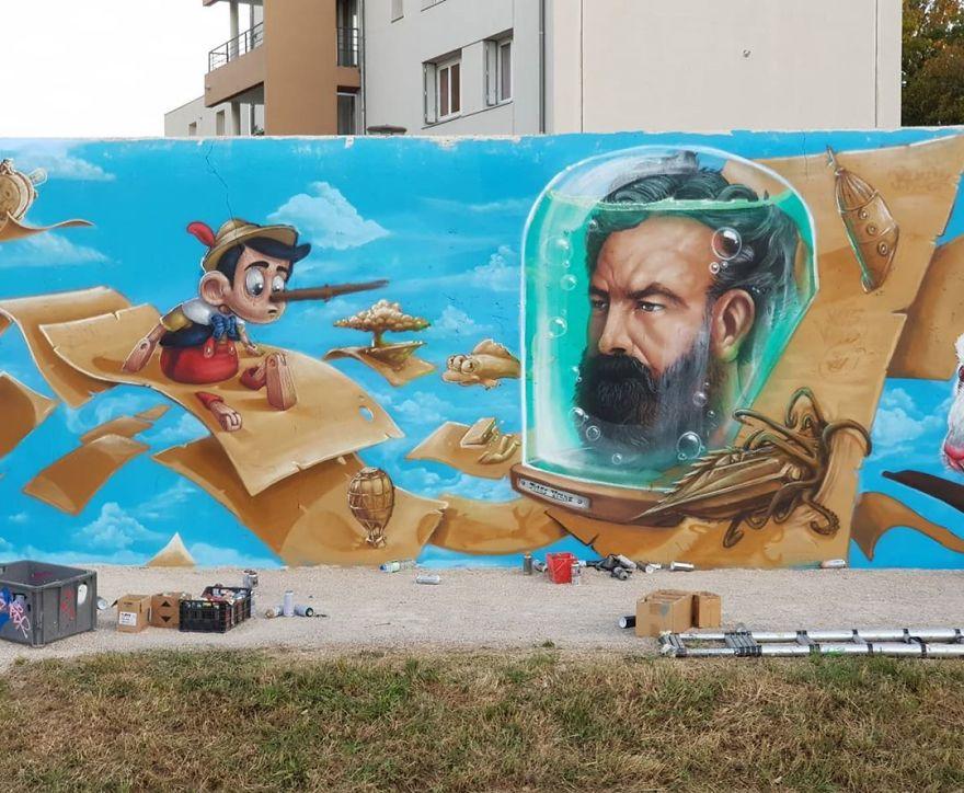 French artist turns an abandoned natural gas tank into a giant cat 5e9ed6a3ee8d5 880 - Esse artista de rua é capaz de confundir a mente de qualquer um com suas belas artes ilusionistas